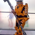 MCM Manchester Comic Con 2016, Cosplay, Cosplayer, Male, Anime, Manga, Comic, Films, Video Game, Fantasy, Sci-Fi, Soilder, Warrior, Weapon, Armour, Metal, Helmet, Orange, Black, Silver